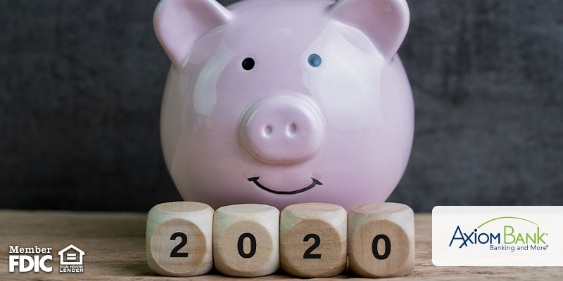 Piggy bank with wooden blocks that say 2020