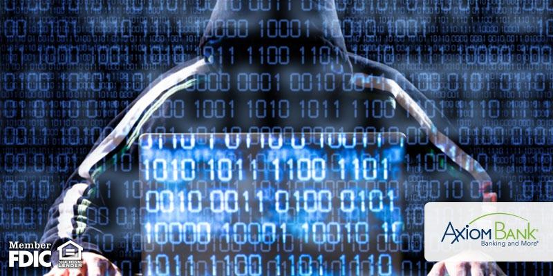 Hacker behind a laptop