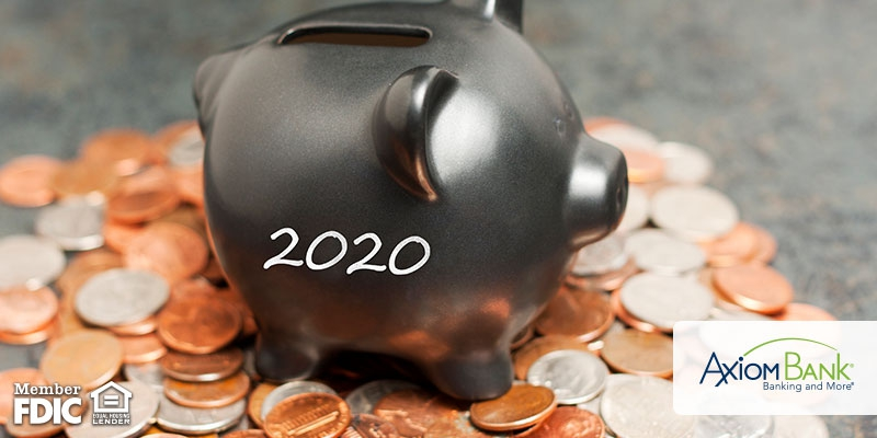 Piggy bank with 2020 on it surrounded by pennies