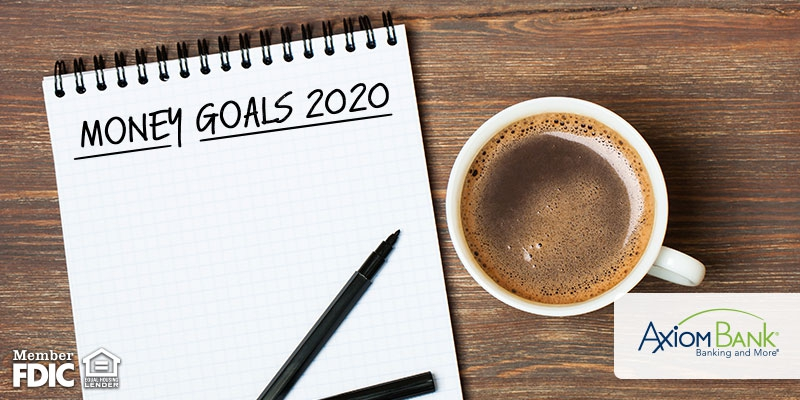 Money goals 2020 on a notebook with coffee