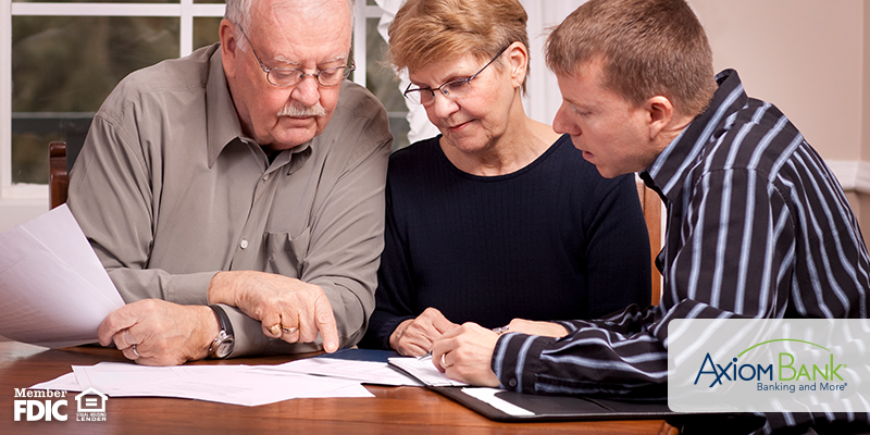 three people going over finances together