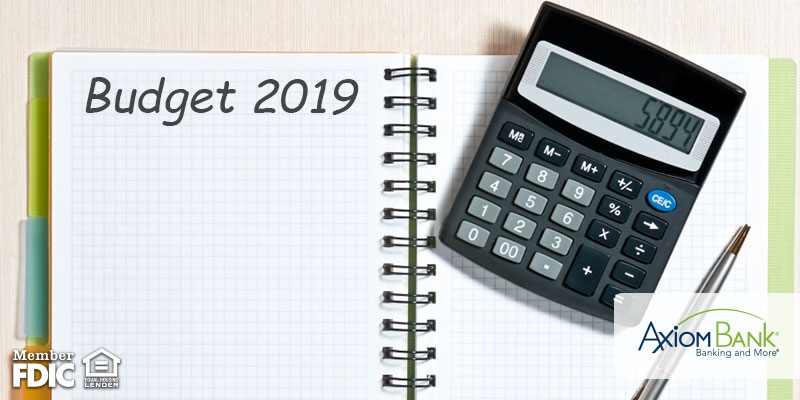 Budget 2019 written on notebook with calculator